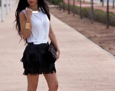 Gold jewelry and fringed skirt