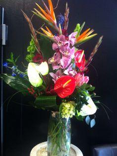Tropical floral arrangement for our client.