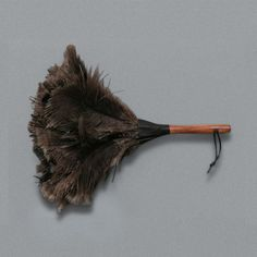 FEATHER DUSTER SMALL  Price £12.00  A real Ostrich feather duster with a lacquered wooden handle. Ostrich feathers are traditionally used for dusting as they have a natural static charge which helps to attract the dust.    Approximate overall length 37cm