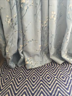 These pretty Laura Ashley 'pussy willow' curtains and a bold geometric rug are going to make lush additions to a master bedroom project. #floral #print #pretty #curtains #print #bold #geometric #rug #blue #bedroom #serene #calm #interiors #interiordesign #interiorstyling #homedecor #home #essex