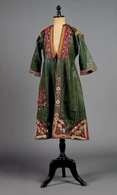 #Macedonian #traditional Bridal 'Sayas' 19th century, This  #bridal #dress of northern #Greece is made of olive-green material with #appliqué panels of red cloth decorated with multicoloured embroideries and tassels. The shoulders, chest and sleeves are trimmed with gold braid. - Macedonia, Pylaia (formerly Kapoudzida), Bridal sayás, H. 1.05 m., late 19th century © Peloponnesian Folklore Foundation, Nafplion, Greece