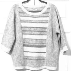 Oversized Dolman Style LOFT Gray Cream Sweater This is preloved but in great shape! Looks sharp with jeans. 3/4 length sleeves. This listing is for sweater only. Boots shown are available in a separate listing in my closet! Last picture best represents true color. LOFT Sweaters Crew & Scoop Necks