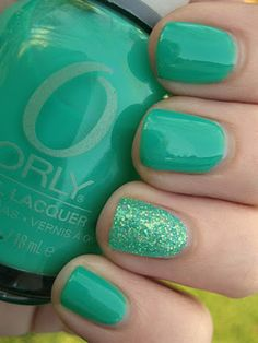 Lacquer and Lattes: Orly Green With Envy and Martha Stewart glitter in Wintermint for the accent nail. I finally found the proper link for this after seeing it on Pinterest a hundred times