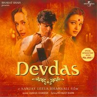 Devdas - Shahrukh Khan, Madhuri Dixit, Aishwarya Rai  A MUST-SEE... at least once. It's a painfully tragic film, but masterfully done and referenced in many other films.
