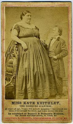 """KATE KEITHLEY, Giant Lady. Carte de visite. 4 ¼"""" x 2 ½"""". Imprinted information on bottom of mount """"The Missouri Giantess...6 feet around the waist, 2 feet around the arm, 675 pounds"""". Ca. 1860 cdv"""