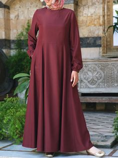 There's something about the Nouria Abaya that gives its wearer a look of poise, simplicity, and gentle elegance. Carefully placed seams that accentuate the feminine figure in a modest way make this Abaya a neat and graceful choice. Gathered sleeves and a flowing skirt complete the look for a piece that is just as special as you are. Made from a light, peach touch modal fabric.