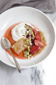 poached rhubarb. greek yogurt. pistachios. strawberries. honeycomb.