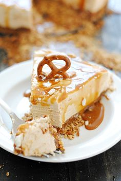 No Bake Peanut Butter Cheesecake with Dulce de Leche and Pretzel Crust | www.somethingswanky.com