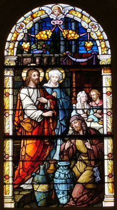 Stained glass window depicting John 2 -- The wedding at Cana where Jesus turned water into wine