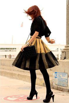 essentially what i wear to work everyday - skirt, fun stockings, and black high heels. love it