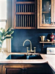 Navy wall, distressed cabinets, light countertop