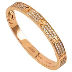 Cartier Diamond Pave Gold Love Bracelet | From a unique collection of vintage bangles at https://www.1stdibs.com/jewelry/bracelets/bangles/