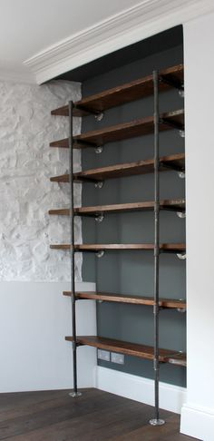 reclaimed wood industrial shelves idea supported by black wrought iron pipes and made of hardwood of Dislike Mainstream Kitchen Shelving? These Tens Industrial Kitchen Shelving Ideas Might Be Your Favorite