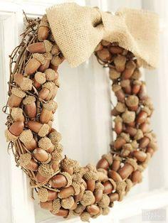 Fall Decorating Ideas | Make a simple fall wreath by hot gluing acorns to a grape vine wreath form.