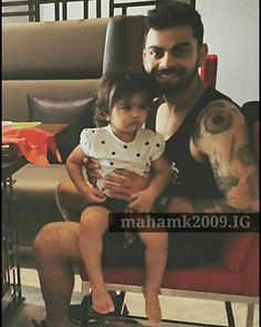 Virat kohli with a fan's daughter