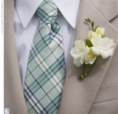 Boutonniere: white freesia accented with hypericum berries. Another great look! Suggested for cooler weather.