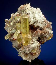 Fluorapatite and Quartz on Hematite matrix - Cerro de Mercado Mine, Cerro de los Remedios, Mun. de Durango, Durango, Mexico
