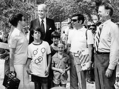 Mr. and Mrs. Nile Bowman and their three children, Scott, 11, Danny, 10, and Ramona, 8, center, of Johnson City, Tenn., are welcomed as the one millionth visitors to the Orpyland U.S.A. theme park Aug. 16, 1972. Extending the welcome is William C. Weaver, back left, chief executive officer of National Life and Accident Insurance Co., and chairman-elect G. Daniel Brooks, right, of the boards of NLT Corp. and WSM Inc.