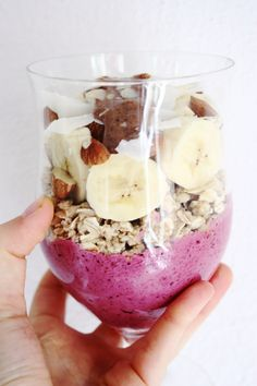 Breakfast parfait - thick banana raspberry blueberry smoothie, granola, rolled oats, banana slices, almonds and almond butter!