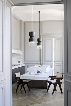 Jean Prouve style modernist chair; heritage apartment; floating marble breakfast bar; traditional paneling