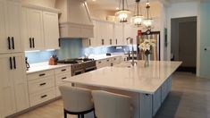 Serene and modern kitchen using a soft Sky Blue Glass Subway Tile as the color pop as the backsplash...gorgeous!