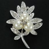 Leaf brooch with Pearls and crystal rhinestone Base metal plated in silver color Height : 2-3/8 inches width 1-3/4 inches