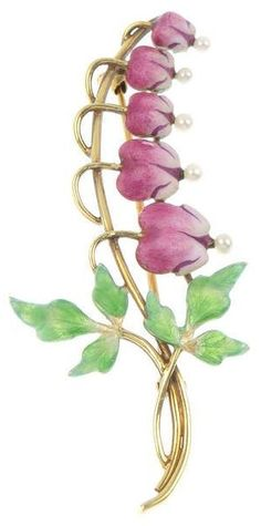 An early 20th century 14ct gold enamel and seed pearl floral spray. Depicting a graduated 'bleeding heart' frond, the pink and white enamel flowers with seed pearl accents, to the green enamel crossover foliate terminal. Maker's mark for Krementz.  #Krementz #vintage