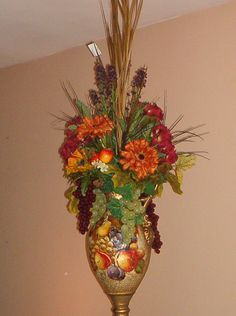 One of mine, customer requested fall fruit arrangement to match the vase.
