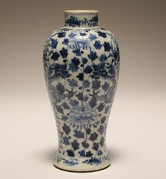 """Late Qing dynasty Chinese blue and white porcelain vase of slender baluster form with underglaze blue design of confronting dragons and floral design. Apocryphal four character Kangxi reign mark. 9""""H. Good condition with a couple of minute nicks to the base and rim."""