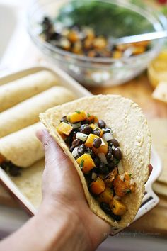 Roasted butternut squash and black bean enchiladas!