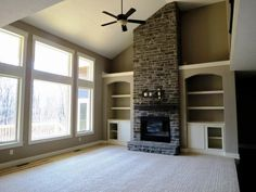 2 story great room with fireplace & stone example