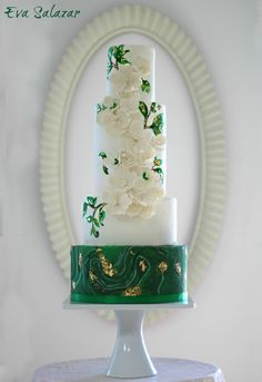 A gallery of fondant and gum paste wedding cakes from cake decorators around the world inspired by the color green. #weddingcakes