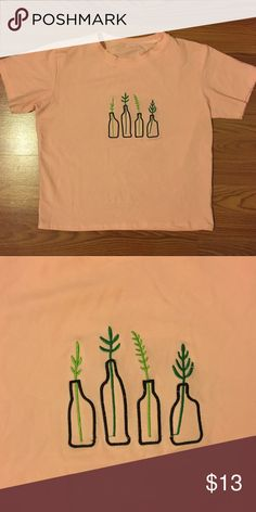 Boxy pink top Light pink top with embroidered plants in the center. In amazing condition. Fabric is super stretchy. ROMWE Tops Tees - Short Sleeve