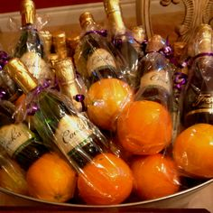 Brunch/bach/bridal shower party favors! mini champagne bottle + orange in a clear party favor sack. about $3.75 per bag.
