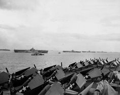 Four Essex-class carriers at anchor at Ulithi Caroline Islands about 1600 on 2 December 1944. From left: Wasp Yorktown Hornet Hancock. View from Ticonderoga with sight of her F6F-5 Hellcat fighters.