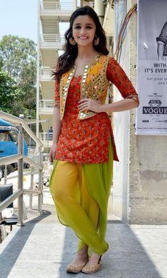 Punjaban look.in an orange kurta worn with a green Patiala salwar and a bright Arpita Mehta vest. Punjabi Dress, Pakistani Dresses, Indian Dresses, Pakistani Mehndi, Walima Dress, Pakistani Party Wear, Churidar, Anarkali, Dhoti Salwar Suits