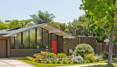 mid-century modern front windows, roof line, entry.