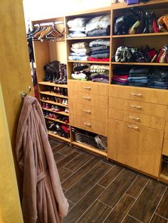 An innovative master closet design was incorporated into Amy's bedroom to make wardrobe maintenance and organization more convenient.