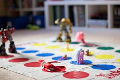 Twister With The Toys — It's games night! This elf was caught getting down with his buddies, including Transformers and My Little Ponies.