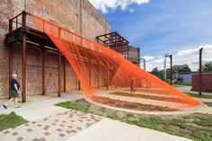 Image 1 of 29 from gallery of Coshocton Ray Trace Installation / Behin Ha. Photograph by Brad Feinknopf Fabric Installation, Artistic Installation, Art Installations, Pedestrian Bridge, Shade Structure, Street Furniture, Skate Park, Built Environment, Outdoor Fabric