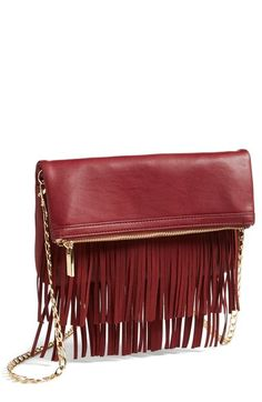 Obsessing over fringe this fall...A fringe clutch has just the right amount of edge!