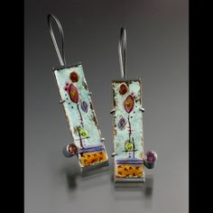 earrings. torch-fired vitreous enamel on copper. painted, wet-packed, sgraffito. sterling silver, copper, .25ct each rhodolite garnet. pierced, soldered, oxidized, tab & tube set.