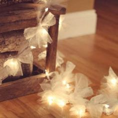 This is a beautiful way to dress up your traditional Christmas Lights! Using tulle or lace cut into squares you'll turn a strand of lights into a lovely set out as a lights display! Easy and inexpensive, yet beautiful and festive!