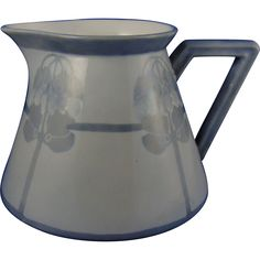 Offered for purchase is a beautiful Delinieres  Co. (DCo.) Limoges Arts  Crafts Monochromatic Organic Motif Pitcher (c.1900-1920).  The stunning