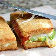Gruyere grilled cheese sandwich with avocado and heirloom tomato.