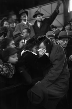 The arrival of a boat carrying refugees from Europe reunites a mother and son who had been separated throughout the war. By Henri-Cartier Bresson, 1946.  repost with info.