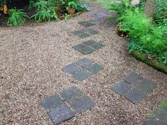 Rustic pathway I designed and installed in a semi-shaded garden using pavers and peametal - lots of trees in this garden - great place to work when the sun's blazing in summer (and great drainage in winter too!).