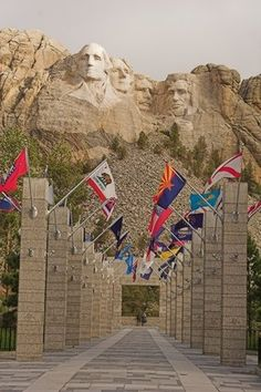 Aisle of state flags leading to Mount Rushmore.