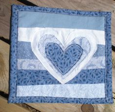 Check out this item in my Etsy shop https://www.etsy.com/listing/230371080/rustic-blues-heart-applique-folk-art