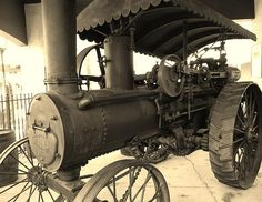 Steam Powered Tractor 1902- is located near the Old Jail in St. Augustine,FL. Quality Prints Available.